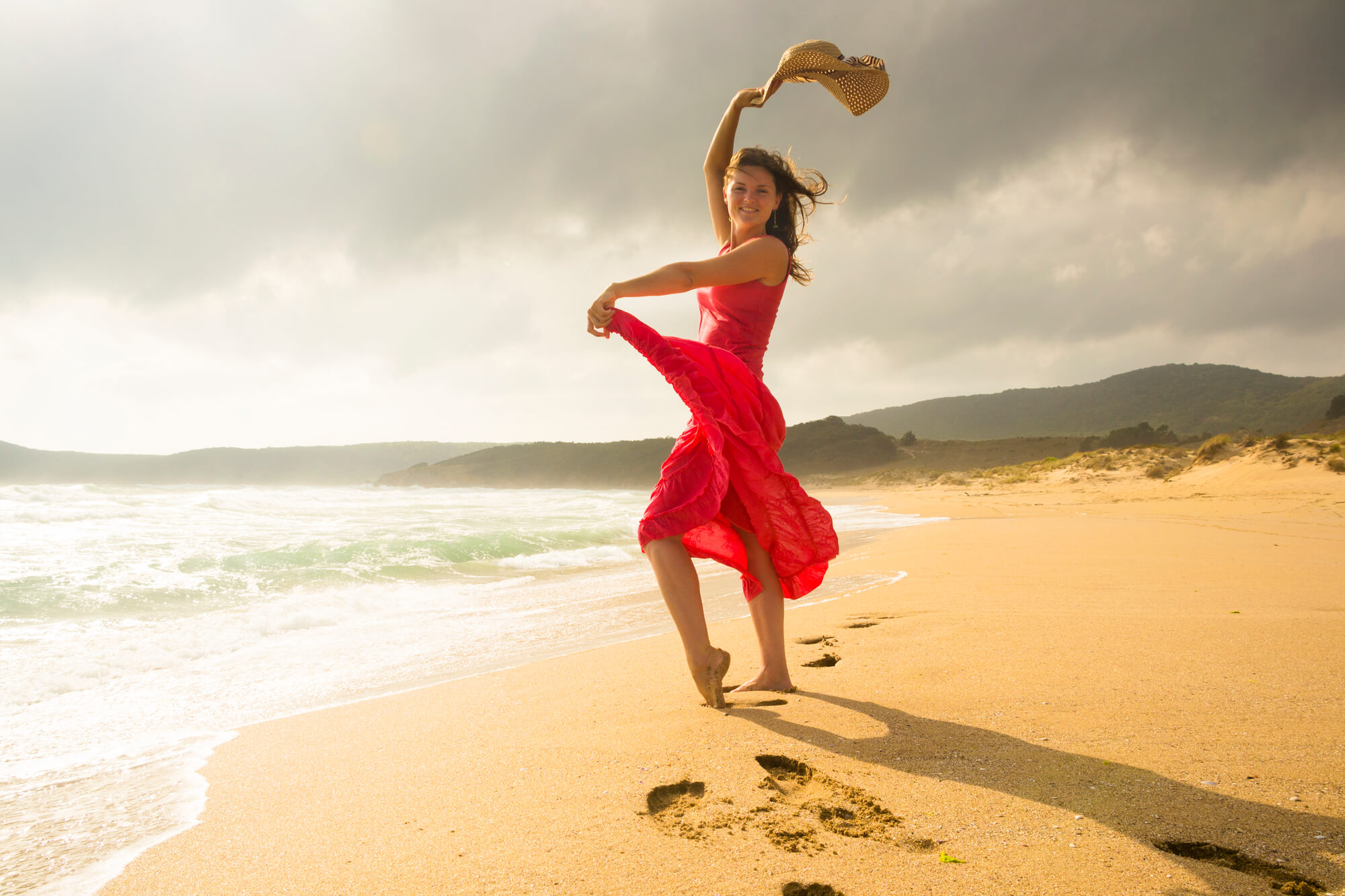 Woman dancing on beach