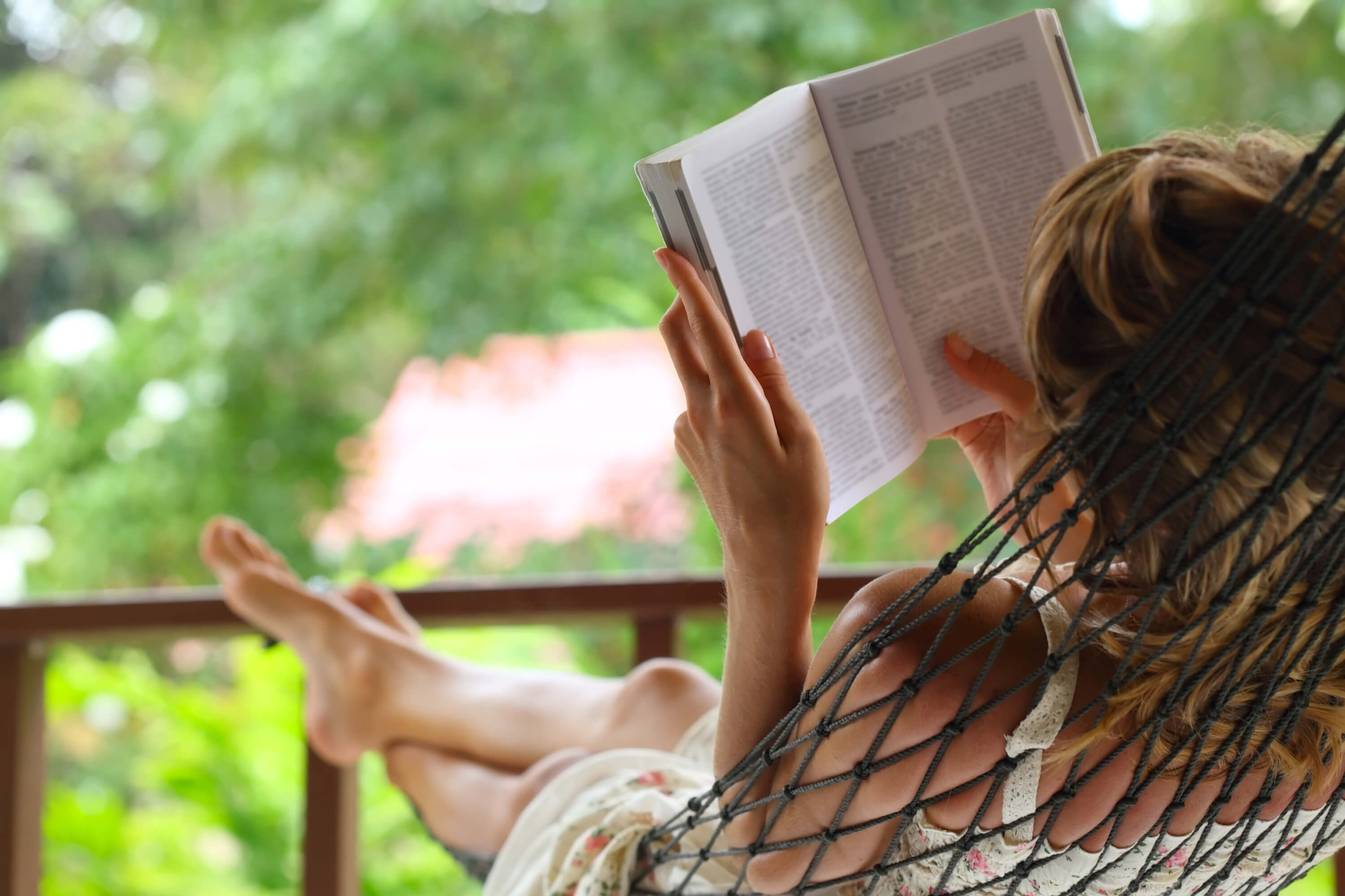 Woman relaxing, reading a book
