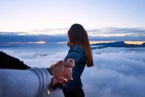 Leap of faith woman holding hands