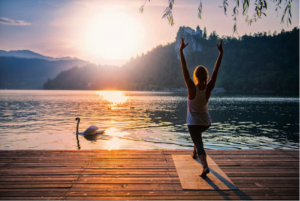 lady doing yoga by water