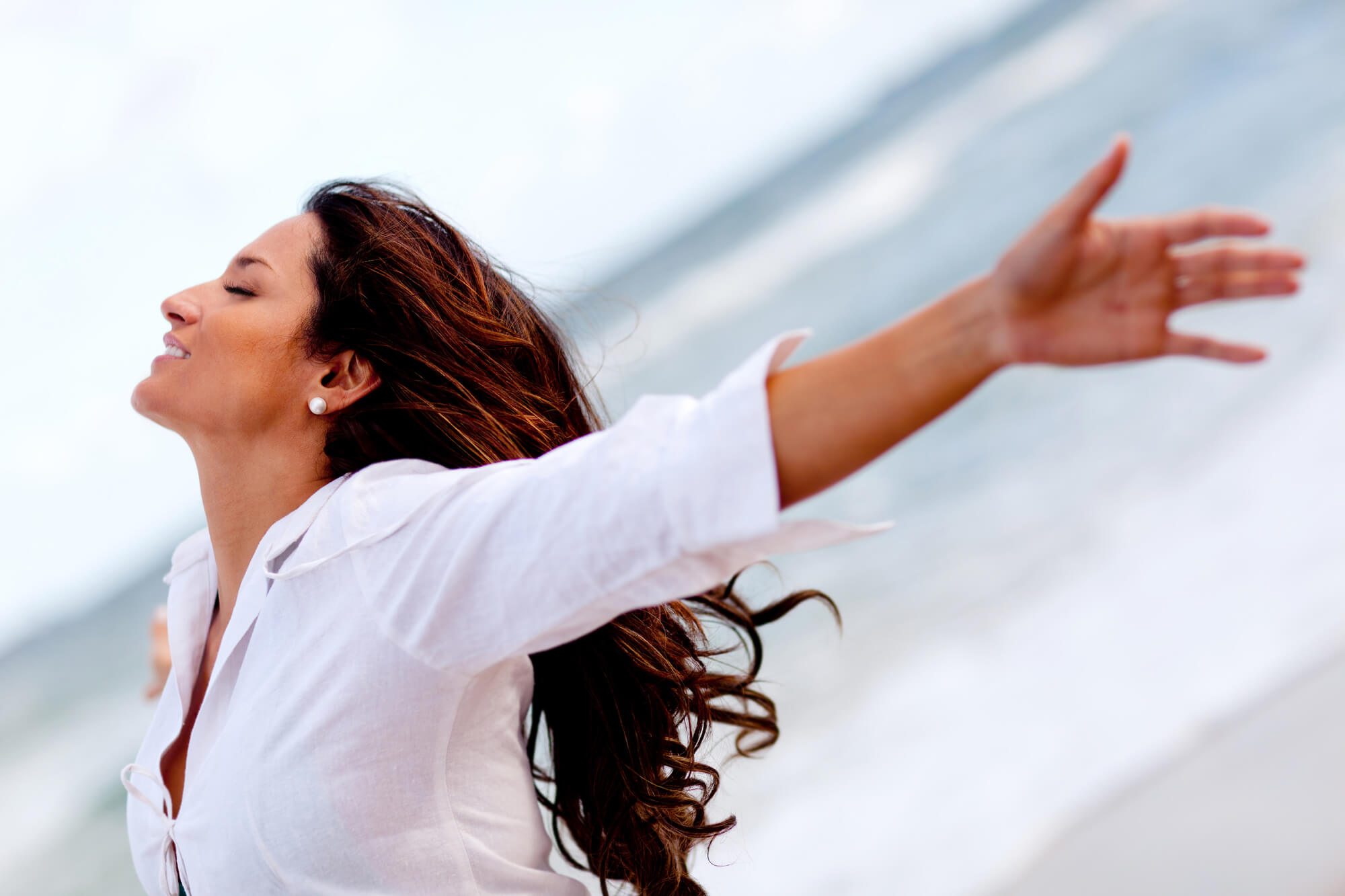 Happy Woman with arms outstretched