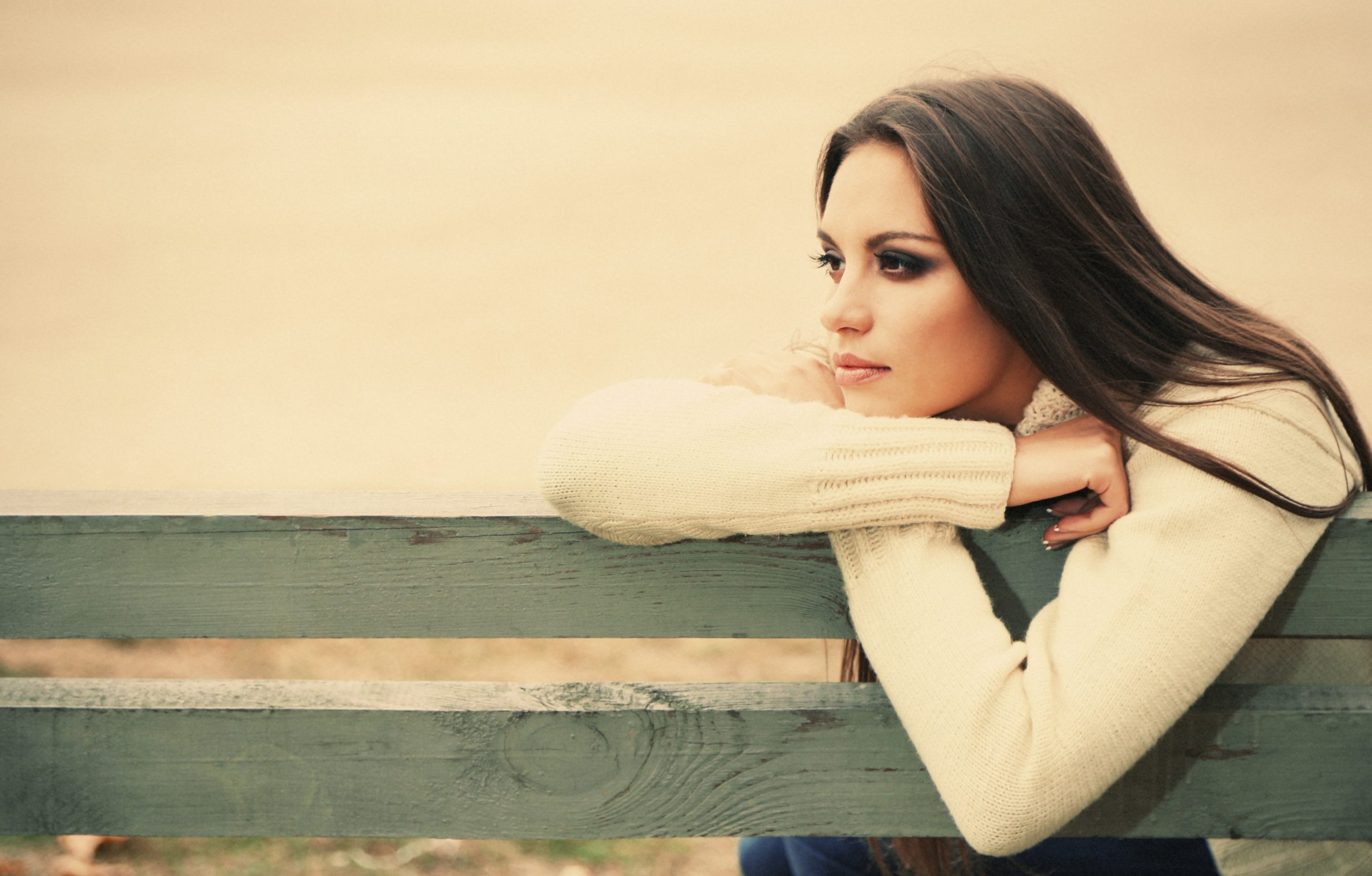 Woman on bench looking out
