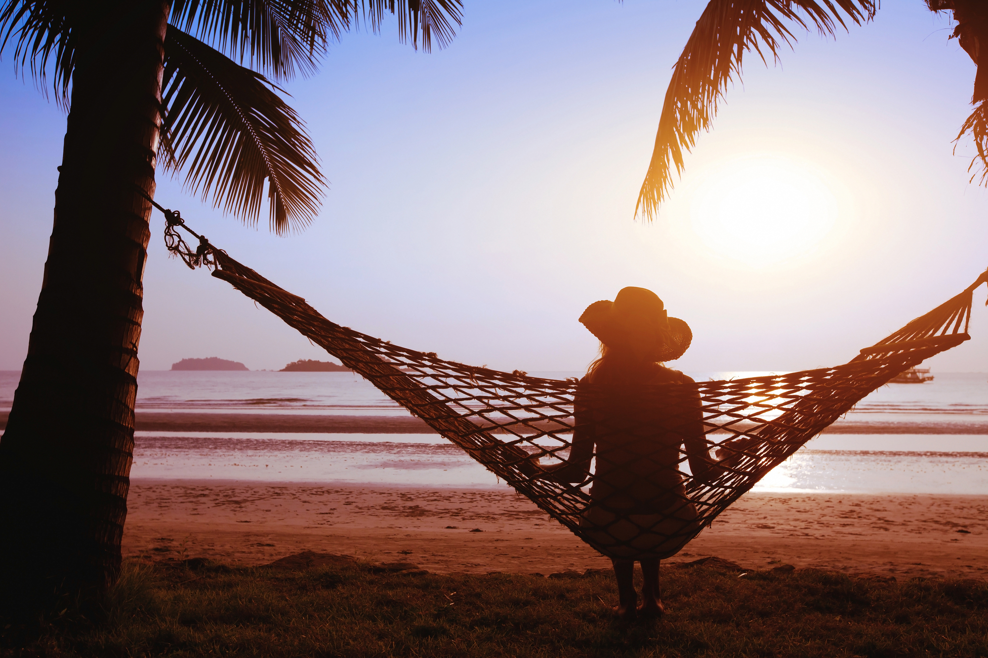 Woman relaxing on hammock looking out to see